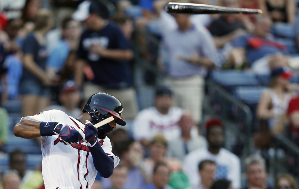Photo - Atlanta Braves' Jason Heyward (22) breaks his bat as he fouls off a pitch in the third inning of a baseball game against the New York Mets in Atlanta, Tuesday, July 1, 2014. The bat sailed into the crowd but no one was injured. (AP Photo/John Bazemore)
