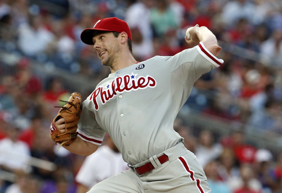 Photo - Philadelphia Phillies starting pitcher Cliff Lee throws during the third inning of a baseball game against the Washington Nationals at Nationals Park Thursday, July 31, 2014, in Washington. Lee left the game later in the third inning. The Phillies announced that Lee had a recurrence of the left flexor pronator strain that sidelined him in May. (AP Photo/Alex Brandon)