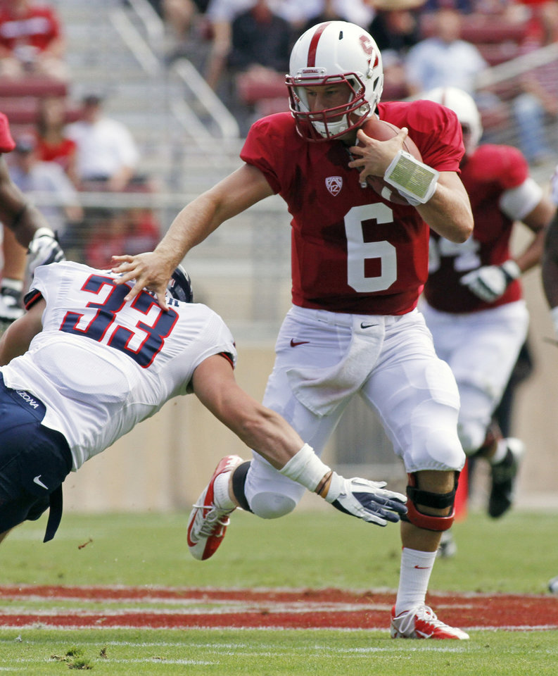 Photo -   Stanford quarterback Josh Nunes runs with the ball past Arizona's Jake Fischer during the first half of an NCAA college football game in Stanford, Calif., Saturday, Oct. 6, 2012. (AP Photo/George Nikitin)