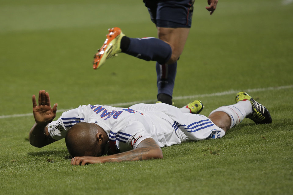 Photo - Lyon's Jimmy Brian reacts during their French League One soccer match against Paris Saint Germain, in Lyon, central France, Sunday, April 13, 2014. (AP Photo/Laurent Cipriani)