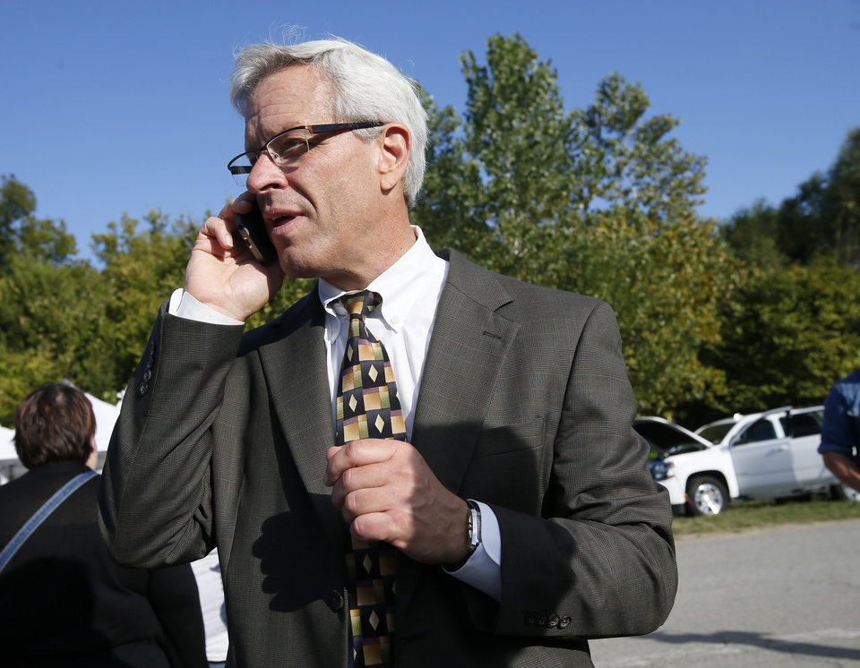 Photo - Don Knight, attorney for Richard Glossip, talks on the phone to Glossip after the scheduled execution of Richard Eugene Glossip was stayed at the Oklahoma State Penitentiary in McAlester, Okla., Wednesday, Sept. 30, 2015. Gov. Fallin stayed the execution for 37 days. Photo by Nate Billings, The Oklahoman