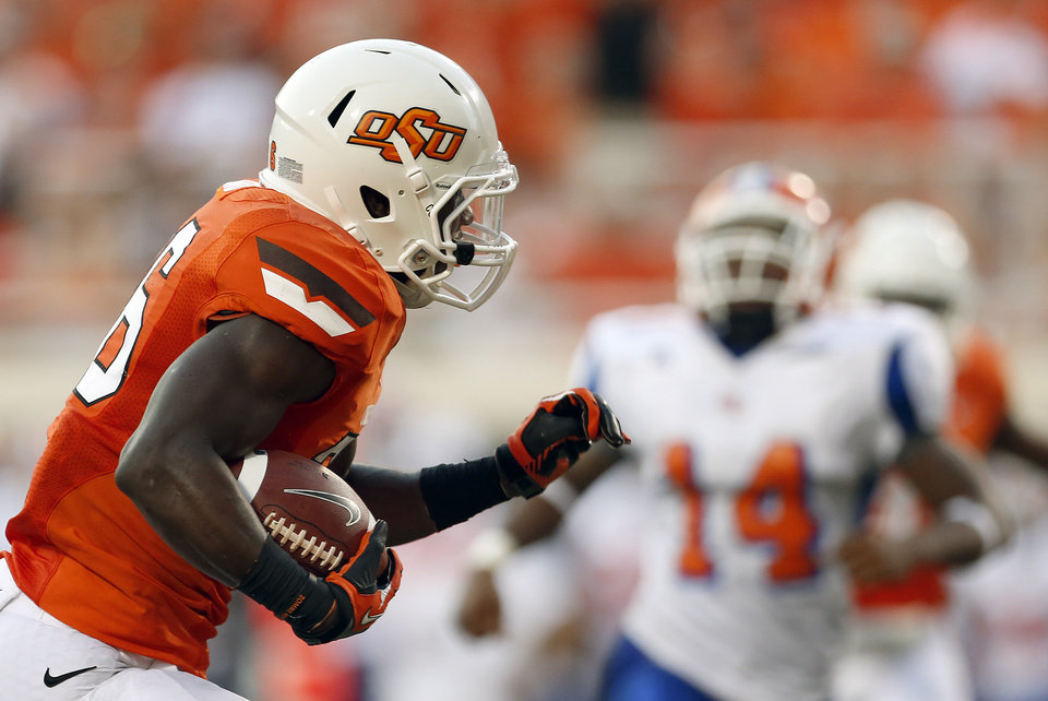 Photo - Oklahoma State's Desmond Roland (26) scores a touchdown during a college football game between Oklahoma State University (OSU) and Savannah State University at Boone Pickens Stadium in Stillwater, Okla., Saturday, Sept. 1, 2012. Photo by Sarah Phipps, The Oklahoman