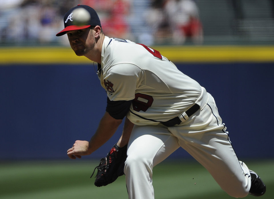 Photo - Atlanta Braves starting pitcher Alex Wood delivers to the San Francisco Giants during the first inning of a baseball game on Sunday, May 4, 2014, in Atlanta. (AP Photo/David Tulis)