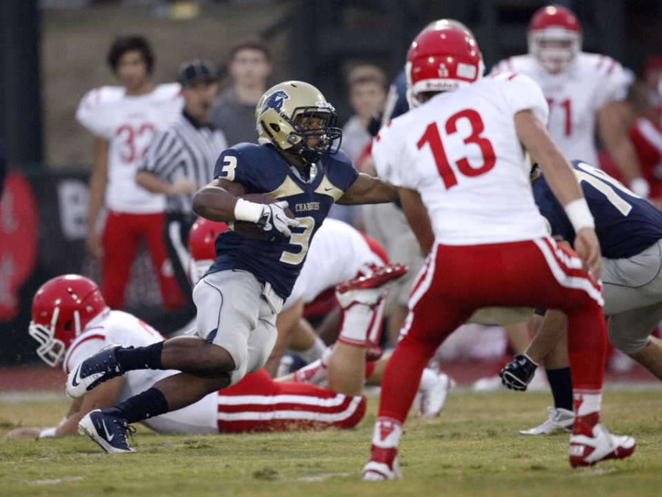Photo - Heritage Hall's Sterling Shepard looks to get past Davis' Chance Griffin during the high school football game between Davis and Heritage Hall in Oklahoma City, Okla., Friday, Sept. 16, 2011. Photo by Sarah Phipps, The Oklahoman