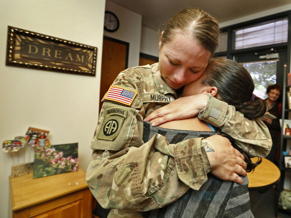 "Army Spc. Jari ""J.J."" Murphy hugs her oldest daughter, Shoshoni, 10, in a tearful reunion at Truman Elementary School. Murphy just returned from nearly a year of service in Afghanistan. PHOTO BY STEVE SISNEY, THE OKLAHOMAN <strong>STEVE SISNEY</strong>"