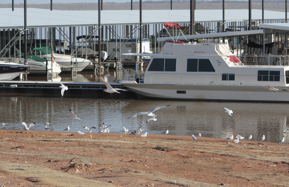 The shore almost meets the pier at the lake's marina as water level at Lake Thunderbird is very low on Thursday, Feb. 16, 2012, in Norman, Okla.   Photo by Steve Sisney, The Oklahoman