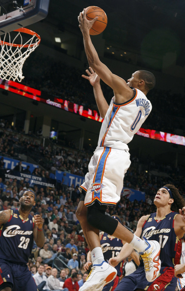 Photo - Oklahoma City's Russell Westbrook (0) shoots a lay up during the NBA game between the Oklahoma City Thunder and the Cleveland Cavaliers, Sunday, Dec. 13, 2009, at the Ford Center in Oklahoma City. Photo by Sarah Phipps, The Oklahoman