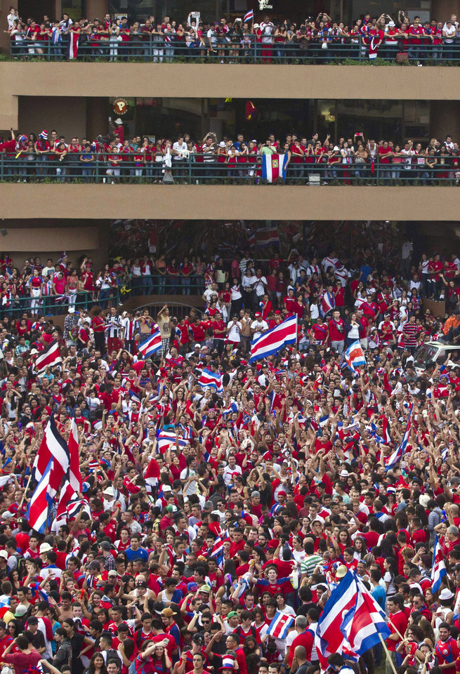 Photo - Costa Rica soccer fans fill the street as they celebrate their team's victory over Greece at a Brazil World Cup round of 16 game in San Jose, Costa Rica, Sunday, June 29, 2014. Costa Rica won a penalty shootout 5-3 after the match ended 1-1 following extra time. (AP Photo/Esteban Felix)