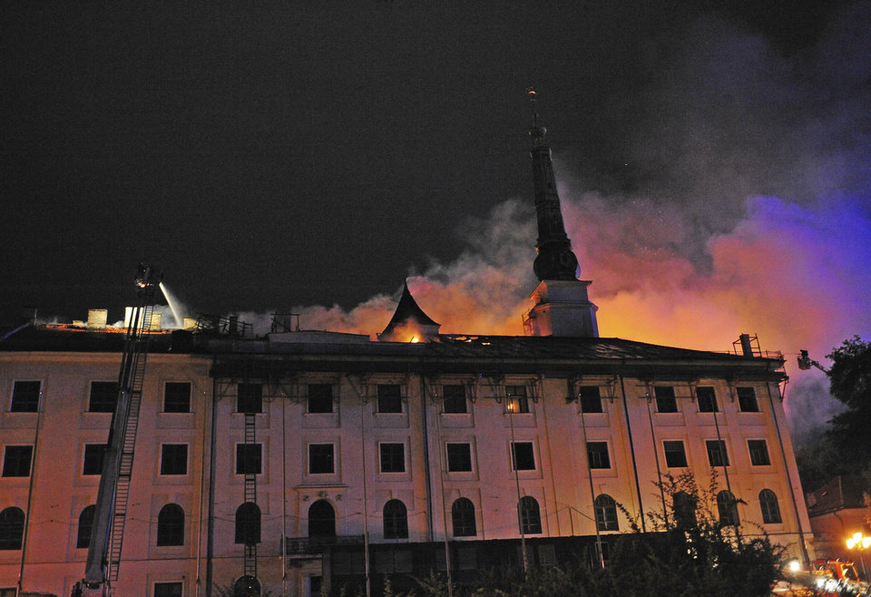 Photo - In this photo released by China's Xinhua News Agency, fire blaze is seen on the roof of Riga Castle, Latvia Thursday, June 20, 2013. The Baltic News Service is reporting that a fire has partially damaged the Riga Castle, a medieval fortress that houses the National History Museum of Latvia. The castle normally serves as the presidential residence, but BNS says Latvian President Andris Berzins is staying elsewhere as the building is being renovated. (AP Photo/Xinhua, Guo Qun) NO SALES