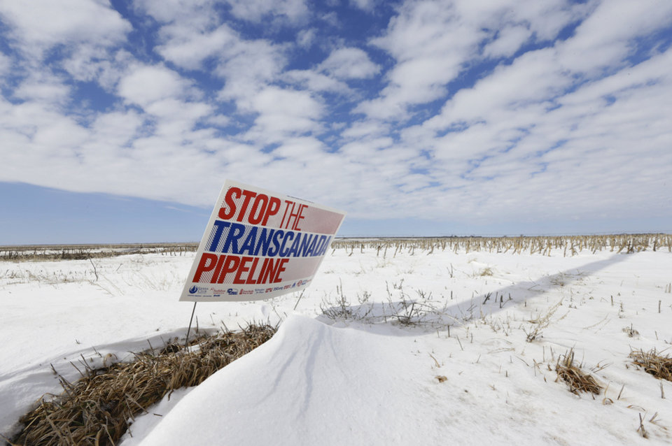 "Photo -  In this March 11, 2013, file photo, a sign reading ""Stop the Transcanada Pipeline"" stands in a field near Bradshaw, Neb. The proposed Keystone XL pipeline will run through this field. In a move that disappointed environmental groups and cheered the oil industry, the Obama administration on Jan. 31, 2014, said it had no major environmental objections to the proposed Keystone XL oil pipeline from Canada. AP Photo   NH -  AP"