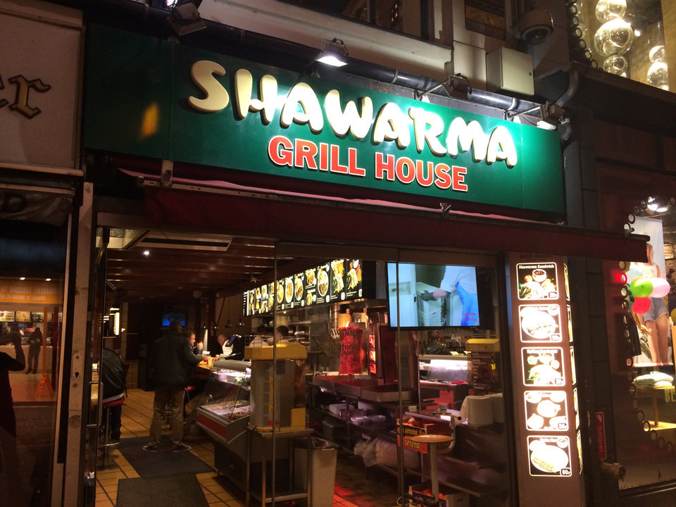 Photo - This May 2014 photo shows  the exterior of Shawarma Grill House in Copenhagen. Shawarma is grilled meat in pita served with lettuce, tomato and a tahini sauce. The eatery has been serving spectacular Middle Eastern comfort food to Danes and tourists for 30 years. (AP Photo/Amir Bibawy)