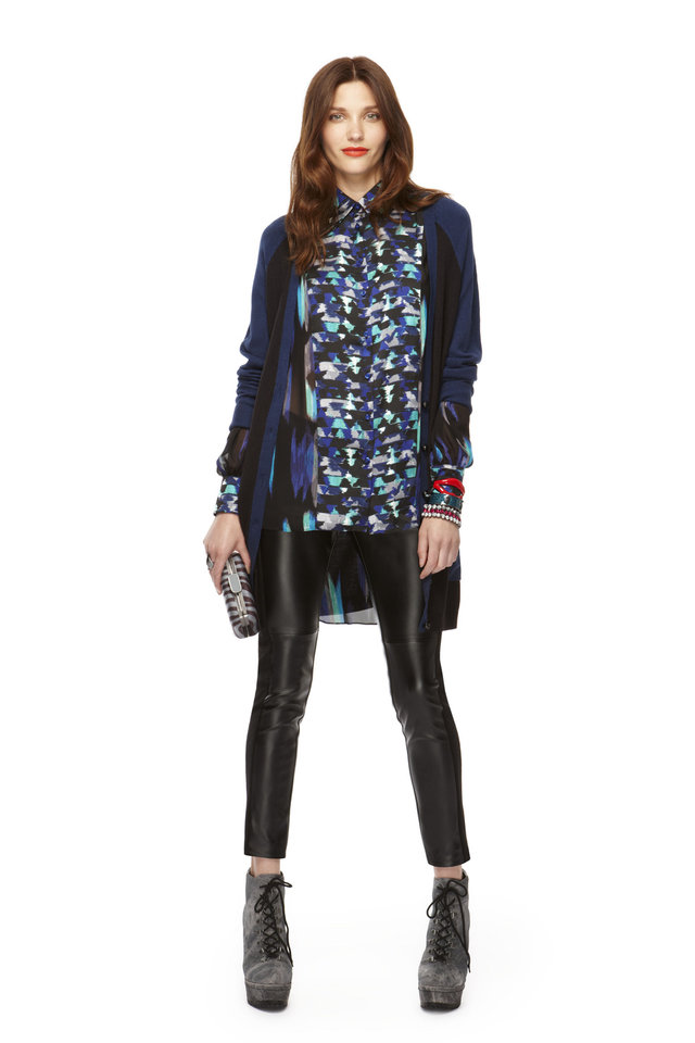 Long-sleeve colorblock cardigan, long-sleeve high-low hem blouse in blue geometric print, faux leather pants, hard case clutch, all from Kirna Zabete for Target collection. Photo provided.