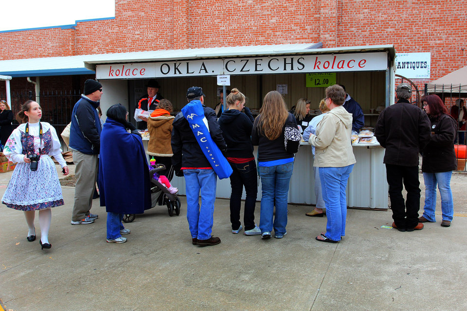 Festival patrons line up to buy kolaces during the 47th annual Czech Festival Saturday in Yukon. PHOTO BY HUGH SCOTT FOR THE OKLAHOMAN