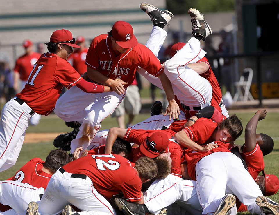Photo - Carl Albert players jump on top of each other near the pitcher's mound after winning the Class 5A high school  state championship baseball game at Edmond Santa Fe High School  Saturday afternoon,  May 11, 2013. Photo  by Jim Beckel, The Oklahoman.