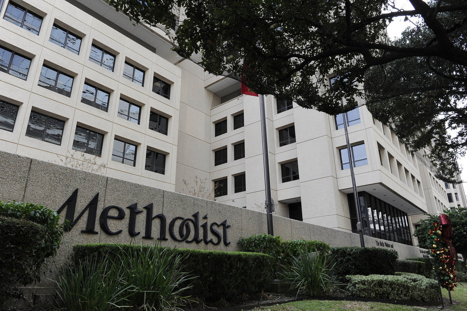 Trees and shrubs line the street in front of Methodist Hospital in Houston\'s Medical Center Thursday, Nov. 29, 2012. Former President George H.W. Bush is at Methodist for treatment of a lingering cough. (AP Photo/Pat Sullivan)