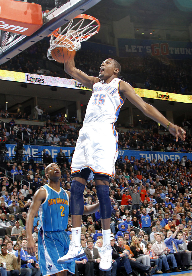Oklahoma City Thunder small forward Kevin Durant (35) dunks the ball over New Orleans Hornets point guard Jarrett Jack (2) during the NBA basketball game between the Oklahoma City Thunder and the New Orleans Hornets at the Chesapeake Energy Arena on Wednesday, Jan. 25, 2012, in Oklahoma City, Okla. Photo by Chris Landsberger, The Oklahoman