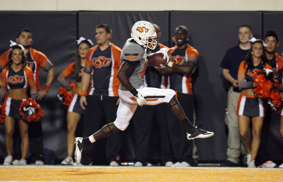 Photo - OSU's Isaiah Anderson scores a touchdown in the fourth quarter of the Cowboys' rout of Lousiana-Lafayette. Photo by Nate Billings, The Oklahoman