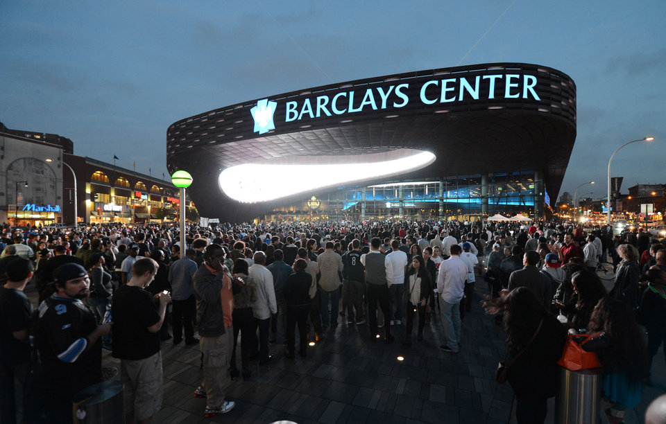 Photo - FILE - In this Sept. 28, 2012 file photo, music fans arrive for the first of eight Jay-Z shows which opended the Barclays Center,  home of the Brooklyn Nets NBA basketball team, in the Brooklyn borough of New York. New York Mayor Bill de Blasio has placed his city's bid for the Democratic Convention in Brooklyn, at the Barclays Center. Officials say the borough's other trendy venues will also lend their cache by hosting various events and parties, from the Brooklyn Academy of Music to the gorgeous Brooklyn Bridge Park along the waterfront. (AP Photo/Henny Ray Abrams, File)