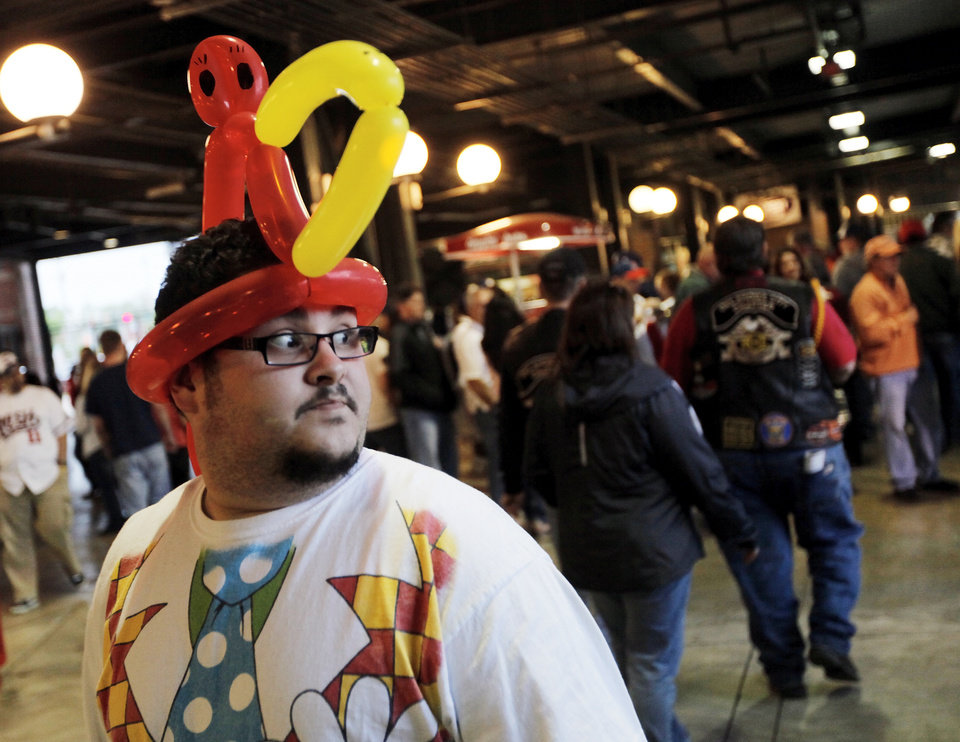 RedHawks fan Aaron Gonzalez walks on the concourse wearing a ballon hat during the 2012 opening day baseball game between the Oklahoma City RedHawks and the Memphis Redbirds at the Chickasaw Bricktown Ballpark in Oklahoma City, Thursday, April 5, 2012. Photo by Nate Billings, The Oklahoman