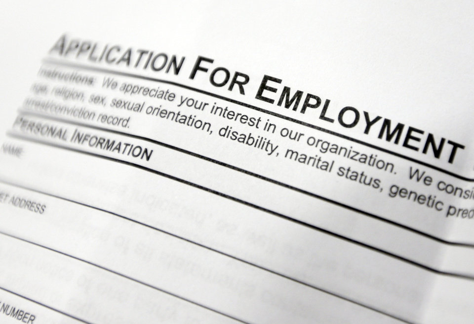 This April 22, 2014 photo shows an employment application form sits on a table during a job fair at Columbia-Greene Community College in Hudson, N.Y. The Labor Department releases employment data for April on Friday, May 2, 2014. (AP Photo/Mike Groll)