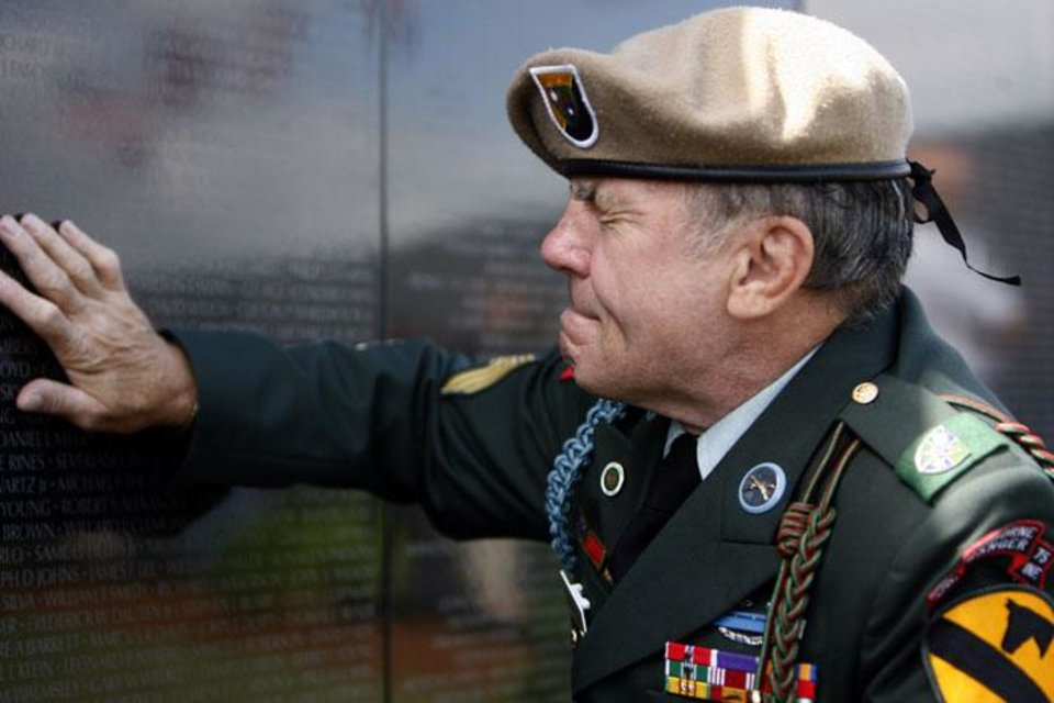 """Photo -  VIRGIL KALBAUGH / VETERAN: Virgil """"Cowboy"""" Kalbaugh places his hand against a panel of the Dignity Memorial Vietnam Wall on the name of Brent Street, Sunday, July 5, 2009, in Piedmont. Photo by Sarah Phipps, The Oklahoman ORG XMIT: KOD"""
