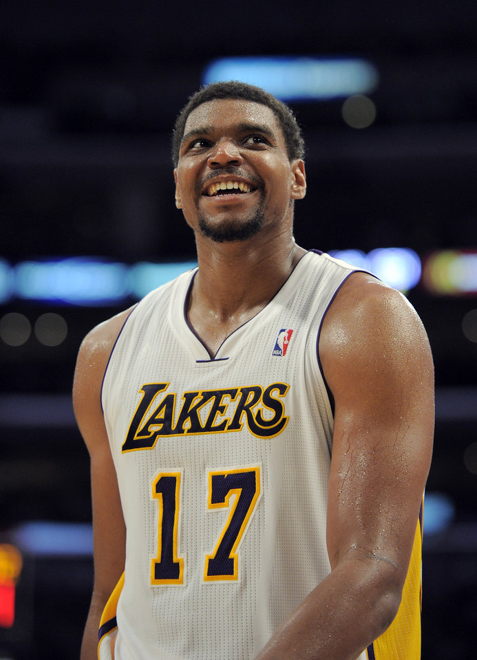 Photo -   Los Angeles Lakers center Andrew Bynum looks toward the scoreboard during the second half of an NBA first-round playoff basketball game against the Denver Nuggets, Sunday, April 29, 2012, in Los Angeles. The Lakers won 103-88. (AP Photo/Mark J. Terrill)