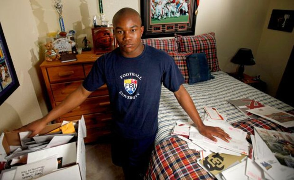 Photo - Heritage Hall's Barry Sanders stands in his room with recruitment letters in Oklahoma City, Saturday, Feb. 12, 2011.  Photo by Bryan Terry, The Oklahoman
