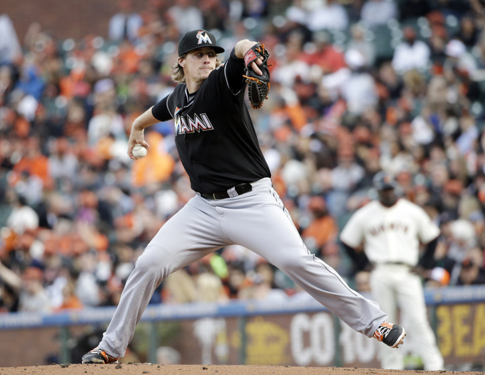 Photo - Miami Marlins starting pitcher Tom Koehler throws to the San Francisco Giants during the first inning of a baseball game on Saturday, May 17, 2014, in San Francisco. (AP Photo/Marcio Jose Sanchez)