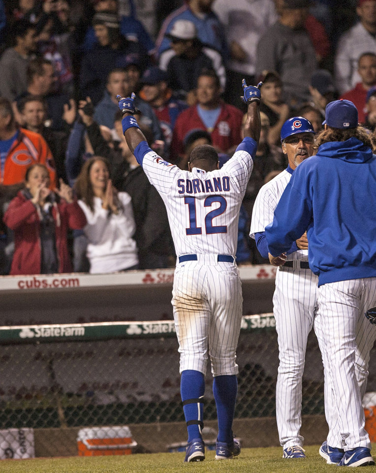 Photo -   Chicago Cubs' Alfonso Soriano waves to crowd after he drove in the winning run in the 10th inning as the Cubs beat the St. Louis Cardinals 3-2 in a baseball game in Chicago on Tuesday, April 24, 2012. (AP Photo/Charles Cherney)