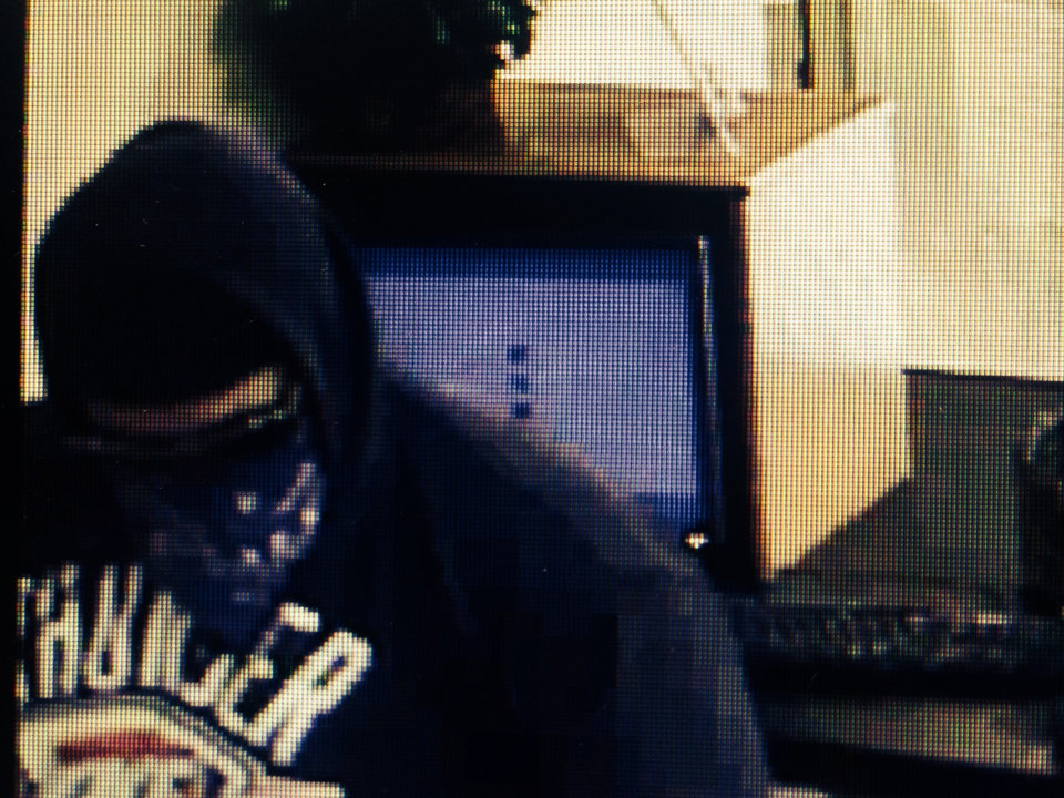 Photo -  About 1:20 p.m. Friday two men and a woman with their faces covered robbed Oklahoma Federal Credit Union, 3210 Bel Aire Drive, in Midwest City. Photo provided