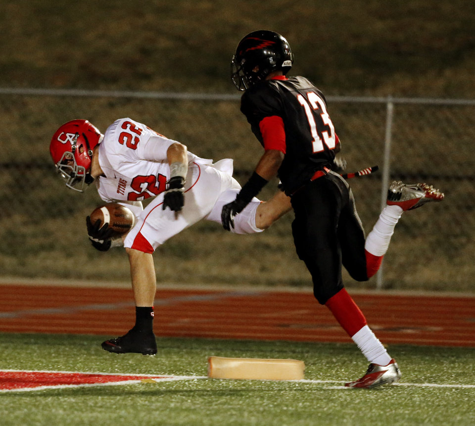 Carl Albert's Garrett Asher is pushed out at the one yard line by Del City's Shawn Epps in Class 5A, first round, playoff action in high school football on Friday, Nov. 9, 2012 in Del City, Okla.   Photo by Steve Sisney, The Oklahoman