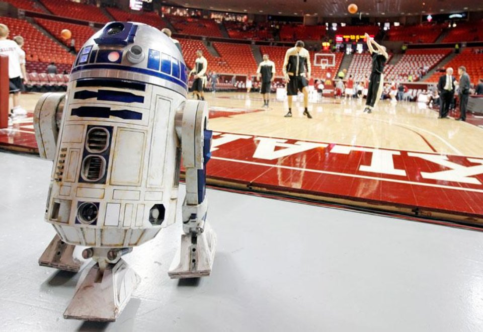 R2-D2 sits by the court as the teams warm up before the men\'s college basketball game between the University of Colorado and the University of Oklahoma at Lloyd Noble Center in Norman, Okla., Saturday, Jan. 22, 2011. This R2-D2 was built and controlled by Chris Campbell of DeWitt, Ark., with the 501st Legion, a group of Star Wars costume enthusiasts. Photo by Nate Billings, The Oklahoman