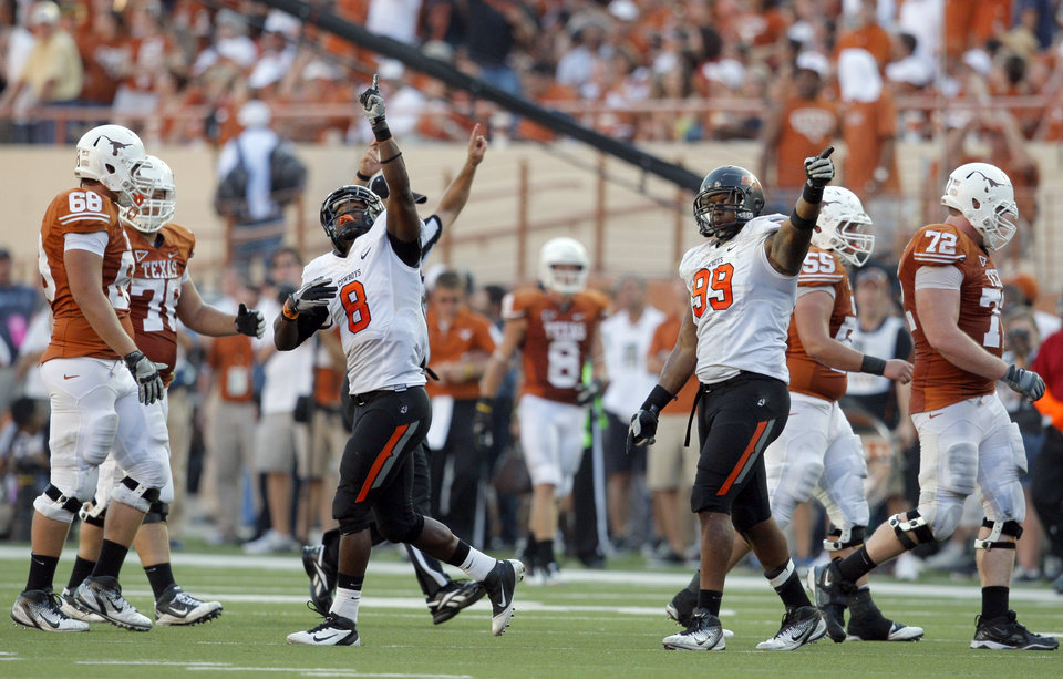 Photo - Oklahoma State's Daytawion Lowe (8) and Richetti Jones (99) celebrate a fumble recovery during second half of a college football game between the Oklahoma State University Cowboys (OSU) and the University of Texas Longhorns (UT) at Darrell K Royal-Texas Memorial Stadium in Austin, Texas, Saturday, Oct. 15, 2011. Photo by Sarah Phipps, The Oklahoman