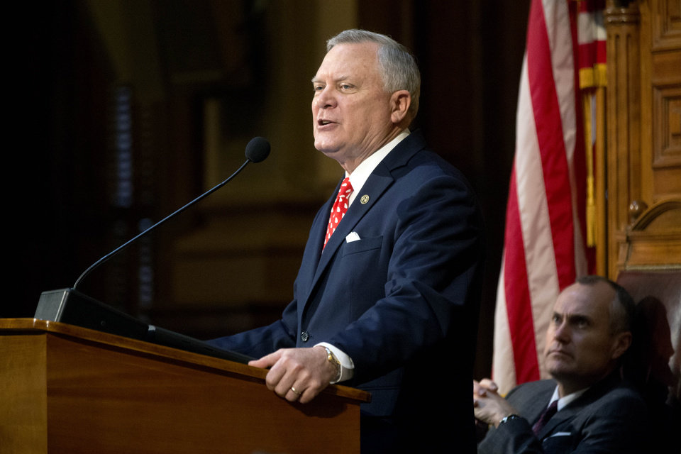 Photo - Georgia Gov. Nathan Deal delivers his State of the State address as Lt. Gov. Casey Cagle, right, watches on the House Floor of the Capitol, Thursday, Jan. 17, 2013, in Atlanta. (AP Photo/David Goldman)