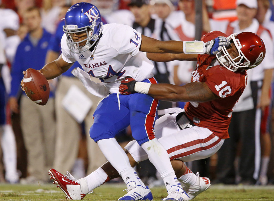 OU's Rashod Favors (10) brings down KU's Michael Cummings (14) during the college football game between the University of Oklahoma Sooners (OU) and the Kansas Jayhawks (KU) at Gaylord Family-Oklahoma Memorial Stadium in Norman, Okla., Saturday, Oct. 20, 2012. Photo by Bryan Terry, The Oklahoman