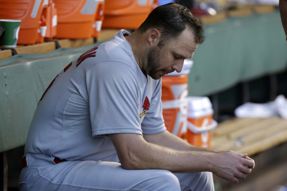 Photo - St. Louis Cardinals starting pitcher Jake Westbrook sits in the dugout during the fourth inning of a baseball game against the Pittsburgh Pirates in Pittsburgh Monday, July 29, 2013. (AP Photo/Gene J. Puskar)