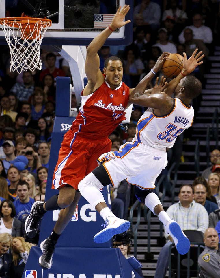 Oklahoma City's Kevin Durant (35) is fouled by the Clippers Ryan Hollins (15) during an NBA basketball game between the Oklahoma City Thunder and the Los Angeles Clippers at Chesapeake Energy Arena in Oklahoma City, Wednesday, Nov. 21, 2012. Photo by Bryan Terry, The Oklahoman