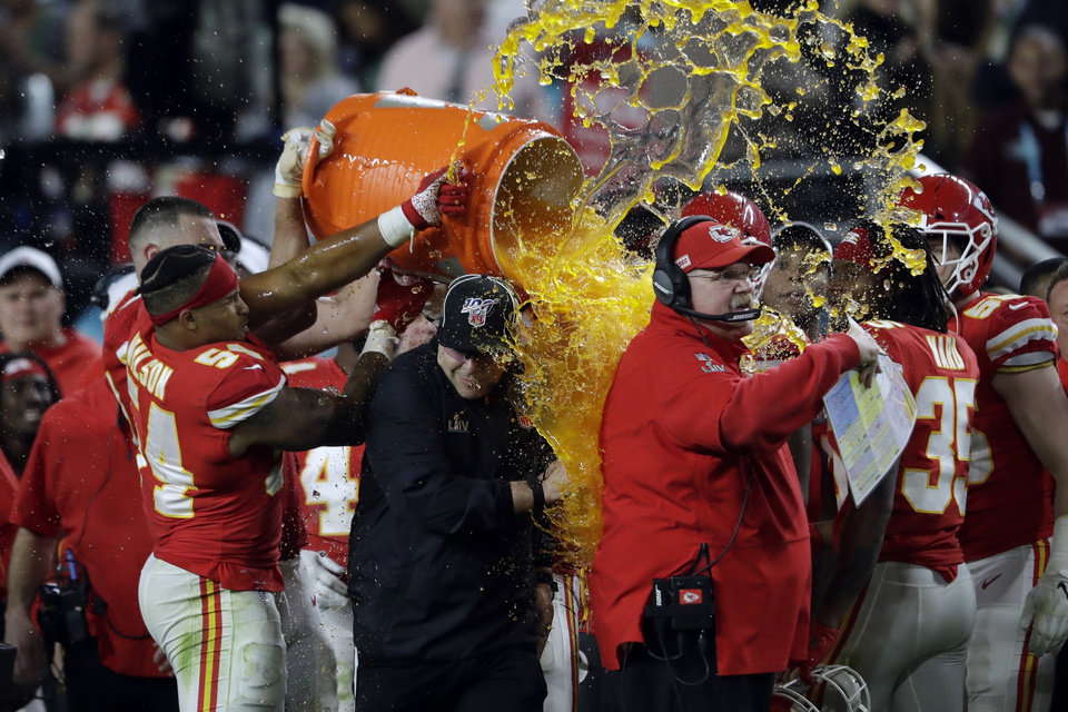 Photo - Kansas City Chiefs head coach Andy Reid is doused on the sideline during the second half of the NFL Super Bowl 54 football game against the San Francisco 49ers Sunday, Feb. 2, 2020, in Miami Gardens, Fla. (AP Photo/John Bazemore)