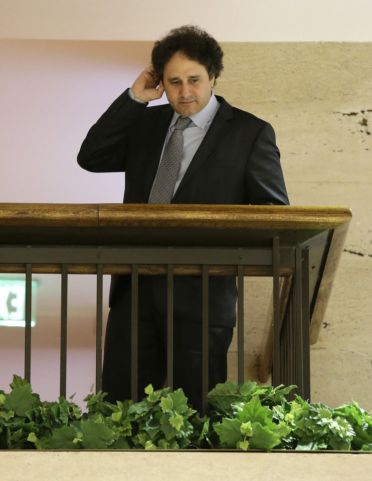 Photo - Sacramento Kings part owner George Maloof talks to a reporter from an overhead floor at a hotel during the NBA Board of Governors meeting Wednesday, May 15, 2013, in Dallas. The meeting is an effort to resolve the five-month-long struggle over the future of the Kings. The board's tasks: Decide whether the team should move to Seattle or stay in Sacramento, and then figure out who should own the troubled franchise. (AP Photo/Tony Gutierrez)
