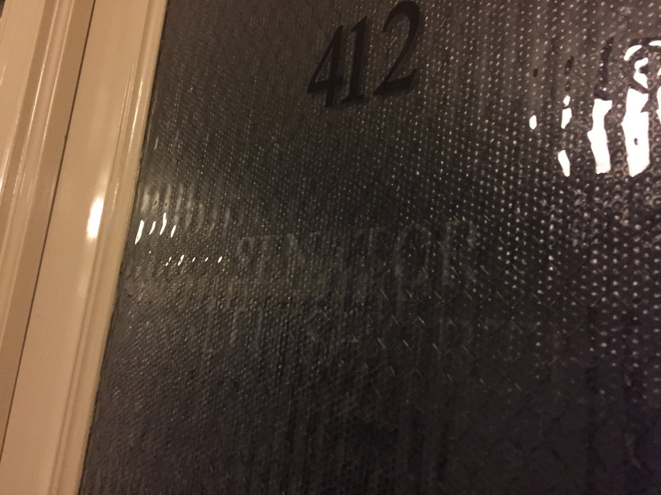 Photo -  State Sen. Ralph Shortey's name was scraped off Room 412, his former office, after the Senate voted to remove his privileges Wednesday. [Photo by Dale Denwalt, The Oklahoman]