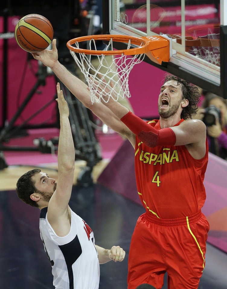 Spain's Pau Gasol shoots against United States' Kevin Love during the men's gold medal basketball game at the 2012 Summer Olympics, Sunday, Aug. 12, 2012, in London. (AP Photo/Matt Slocum)