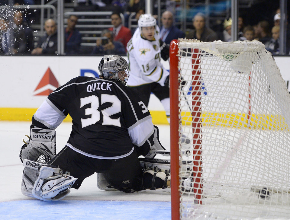 Dallas Stars left wing Ray Whitney, top, scores on Los Angeles Kings goalie Jonathan Quick during the third period of their NHL hockey game, Thursday, March 21, 2013, in Los Angeles. The Stars won 2-0.  (AP Photo/Mark J. Terrill)