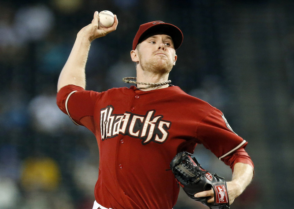 Photo - Arizona Diamondbacks' Chase Anderson throws a pitch against the Colorado Rockies during the first inning of a baseball game Sunday, Aug. 31, 2014, in Phoenix. (AP Photo/Ross D. Franklin)
