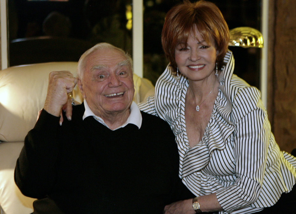 Photo - Actor Ernest Borgnine, left, with his wife Tova, celebrates for the winner moments after he discovered he did not win a Golden Globe Sunday, Jan. 13, 2008, in Beverly Hills, Calif. Borgnine was eligible for Golden Globe's best performance by an actor in a mini-series or motion picture made for television. (AP Photo/Ric Francis) ORG XMIT: CARF102