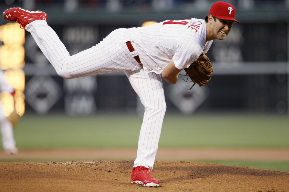 Photo - Philadelphia Phillies' Jonathan Pettibone follows through on his delivery during the first inning of a baseball game against the Miami Marlins, Saturday, April 12, 2014, in Philadelphia. (AP Photo/Tom Mihalek)