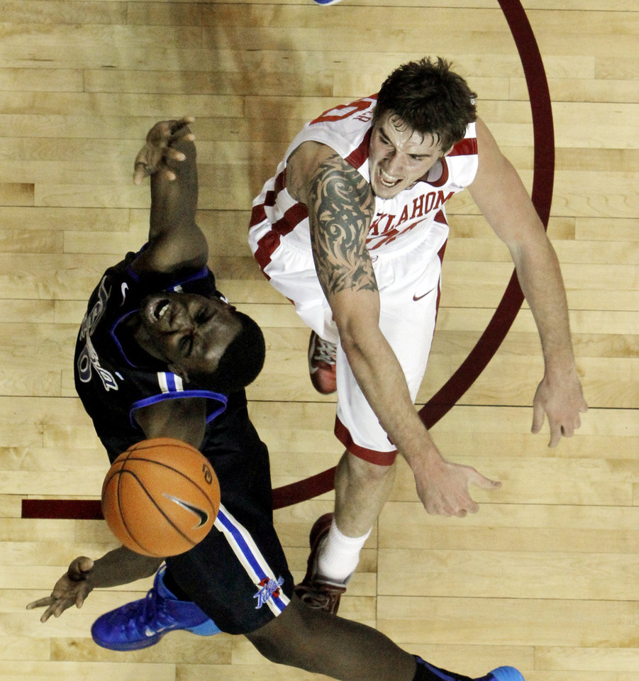 Ryan Spangler blocks a shot by Tulsa's D'Andre Wright (40) as the University of Oklahoma Sooners (OU) men play the Tulsa Golden Hurricane in NCAA, college basketball at The Lloyd Noble Center on Saturday, Dec. 14, 2013  in Norman, Okla. Photo by Steve Sisney, The Oklahoman