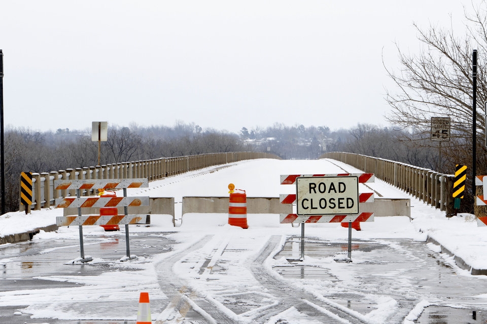 Photo - The James C. Nance Memorial Bridge that links Purcell and Lexington remains closed Monday. The bridge was closed last week after an inspection revealed cracking in the beams.