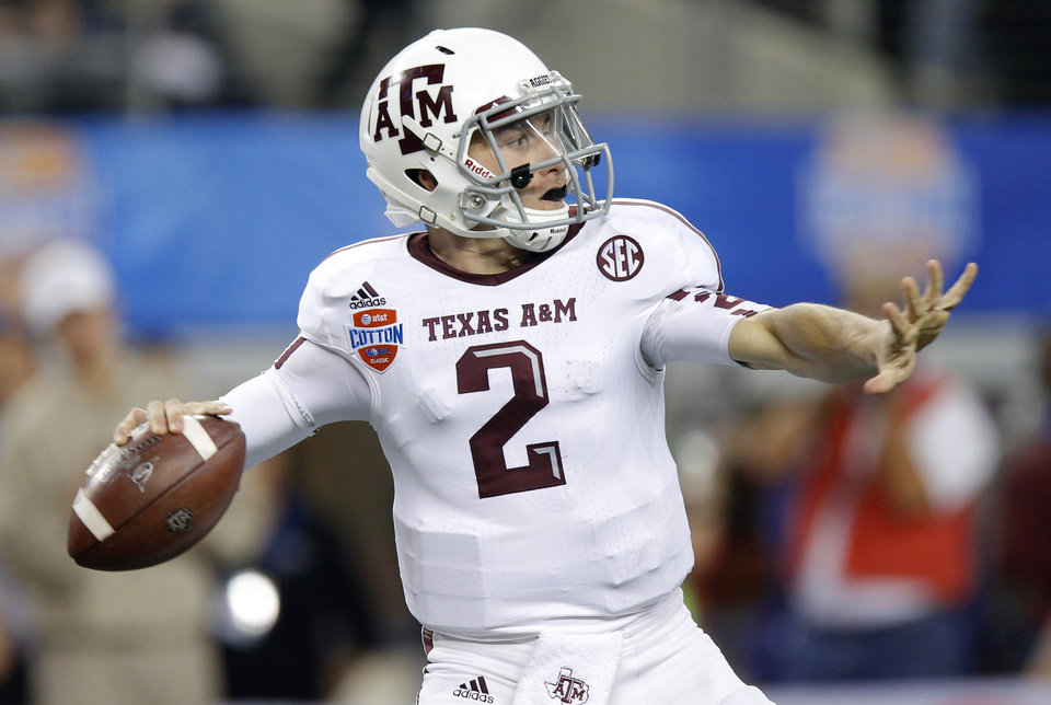 Texas A&M 's Johnny Manziel (2) throws a pass during the Cotton Bowl college football game between the University of Oklahoma (OU)and Texas A&M University at Cowboys Stadium in Arlington, Texas, Friday, Jan. 4, 2013. Oklahoma lost 41-13. Photo by Bryan Terry, The Oklahoman