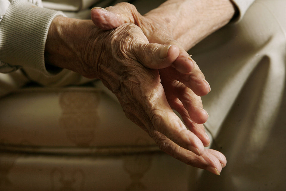 Photo - The hands of Oklahoma City resident Robert Jones, 103, as he talks at his home in Oklahoma City Thursday, Nov. 6, 2008, about this week's presidential election. BY PAUL B. SOUTHERLAND, THE OKLAHOMAN