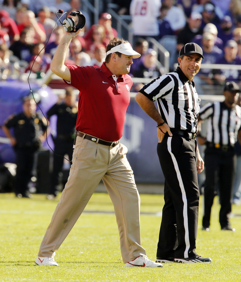 Photo - Head coach Bob Stoops reacts to an incomplete pass call that was later reversed and ruled a fumble by TCU during the second half of the college football game where the University of Oklahoma Sooners (OU) defeated the Texas Christian University Horned Frogs (TCU) 24-17 at Amon G. Carter Stadium in Fort Worth, Texas, on Saturday, Dec. 1, 2012.  Photo by Steve Sisney, The Oklahoman